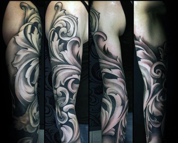 Gentleman mit Full Sleeve Tattoo aus filigranem Design